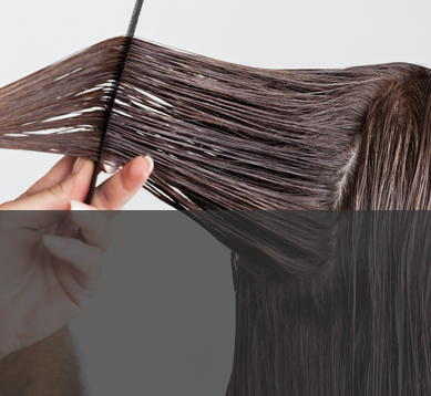 Image of combing hair with personal care additives and specialty surfactants